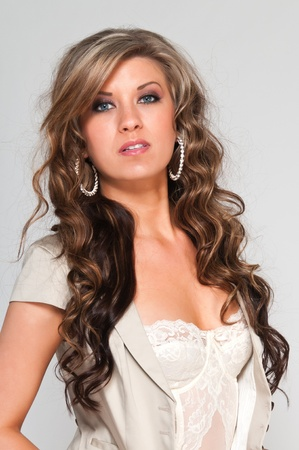 brown: Pretty young woman with wavy brown hair Stock Photo