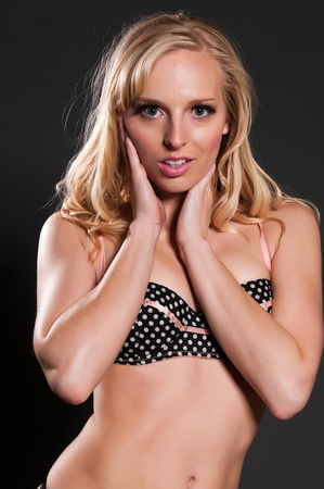 blue eyed: Blue eyed blonde in black polka dot lingerie Stock Photo