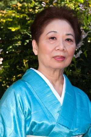 Mature woman in a traditional Japanese outfit photo