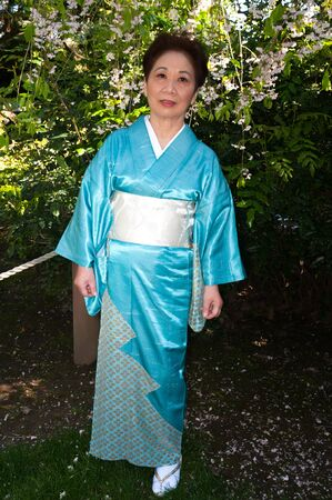 Mature woman in a traditional Japanese outfit Stock Photo - 13248686