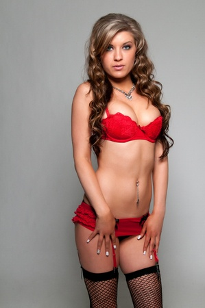 Pretty young brunette in red lingerie photo