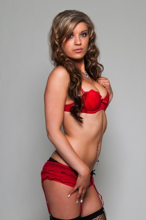 undergarment: Pretty young brunette in red lingerie