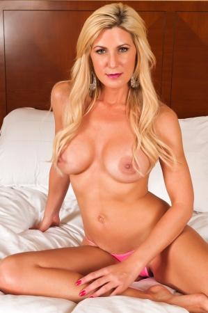 nude blond: Beautiful mature blonde topless in pink panties