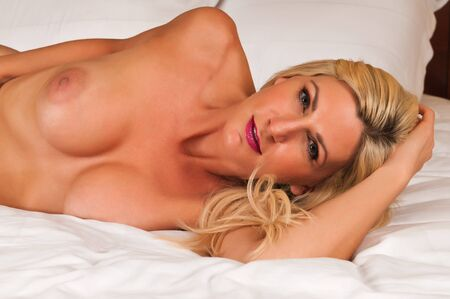 Beautiful mature blonde nude in bed Stock Photo - 13269745