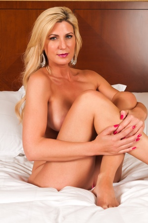 Beautiful mature blonde nude in bed Stock Photo - 13269764
