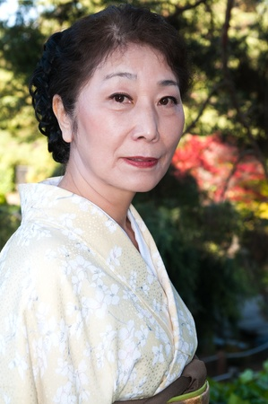 Mature woman in a traditional Japanese outfit