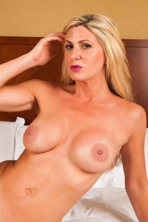 female nudity: Beautiful mature blonde nude in bed