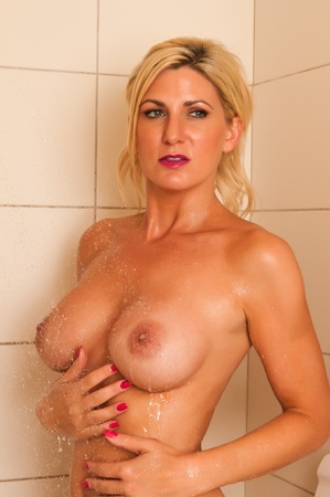 Beautiful mature nude blonde in the shower Stock Photo - 13274396