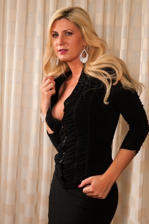 Beautiful mature blonde in a little black dress photo