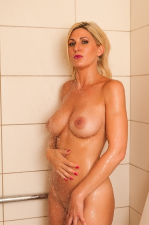 Beautiful mature blonde in the shower Stock Photo - 13327770