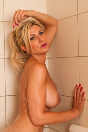 Beautiful mature blonde in the shower photo
