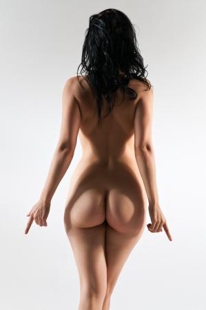 Pretty petite brunette nude on white 写真素材