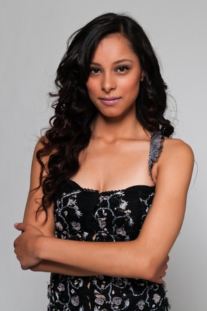 Pretty young Latina in a black sleeveless top photo