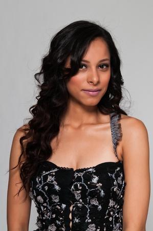 Pretty young Latina in a black sleeveless top Standard-Bild