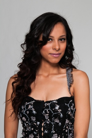 Pretty young Latina in a black sleeveless top Stockfoto