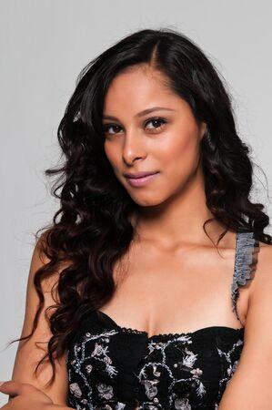 Pretty young Latina in a black sleeveless top Banco de Imagens