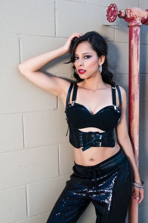 Pretty young Latina in a black bra and pants photo