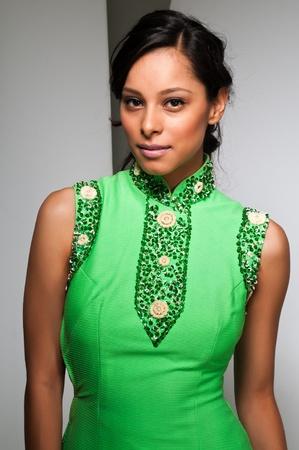 sheath: Pretty young Latina in a green sheath dress