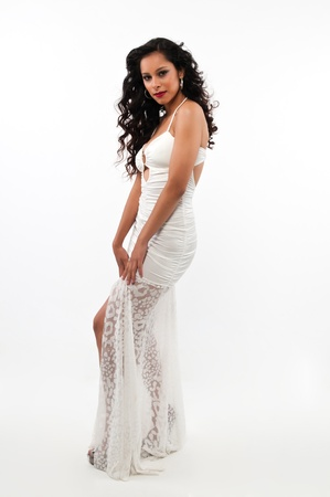Pretty young Latina in a long white gown