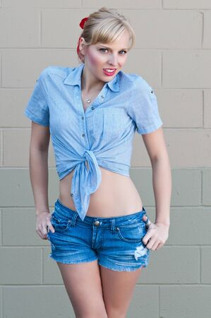 blue eyed: Blue eyed blonde in a check shirt and denim shorts