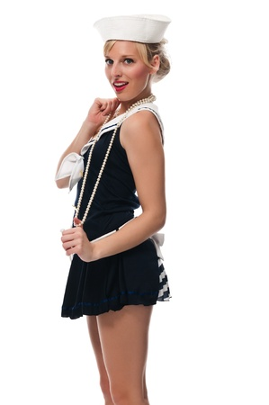 Pretty blue eyed blonde in a sailor suit Stock Photo