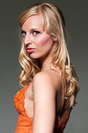 blue eyed: Pretty blue eyed blonde in an orange slip