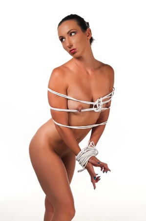 nudity: Athletic nude brunette bound with Ethernet cable Stock Photo