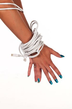 Womans hands bound with Ethernet cable photo