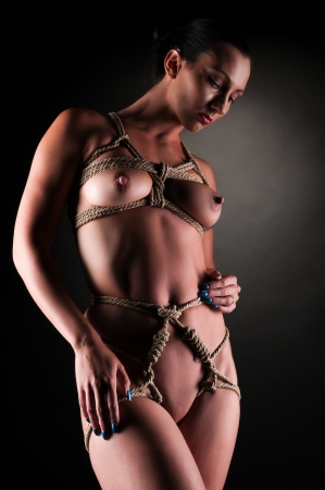 undressed young: Athletic nude brunette bound with rope