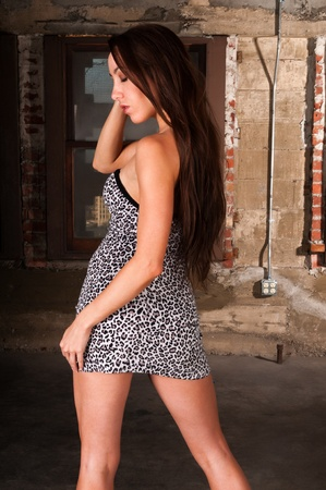 attic: Beautiful young brunette in an industrial attic