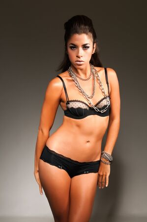 Beautiful young multiracial woman in black lingerie photo