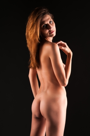 naked woman back: Beautiful tall brunette nude in shadow