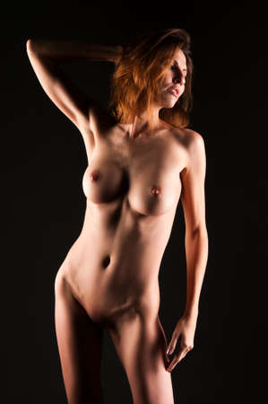 undressed: Beautiful tall brunette nude in shadow