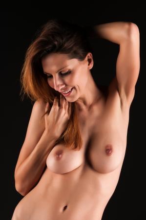 female nudity: Beautiful tall brunette nude in shadow