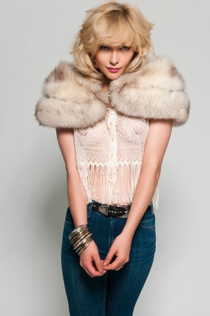 stole: Pretty slim blonde in a fur stole and jeans