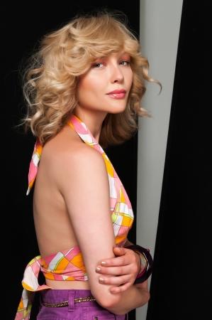 Pretty slim blonde in vintage halter and shorts photo