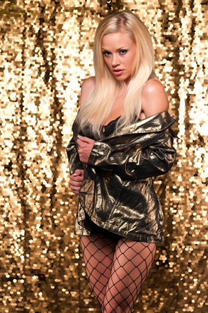 undergarments: Beautiful slender blonde in a gold jacket and black lingerie