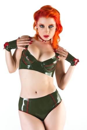 drab: Beautiful pale redhead dressed in olive drab latex