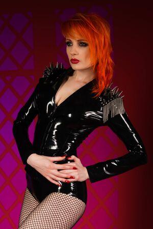 fishnets: Beautiful pale redhead dressed in black latex