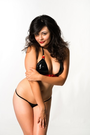 latex fetish: Pretty young multiracial woman in latex underwear Stock Photo