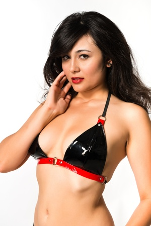 Pretty young multiracial woman in latex underwear photo