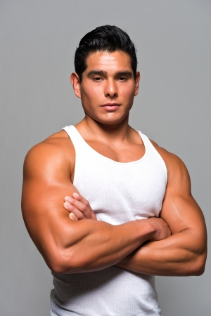 tank top: Athletic young man in a white undershirt Stock Photo