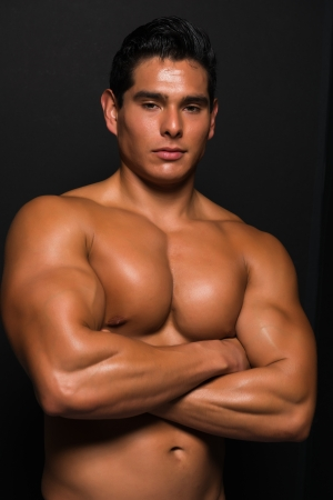 Athletic bare chested young man photo