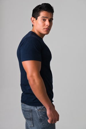 Athletic young man in a blue tee shirt photo