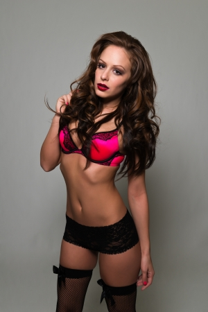 woman bra: Beautiful young brunette in red and black lingerie
