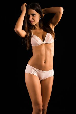 Beautiful slender Romanian brunette in cream colored lingerie