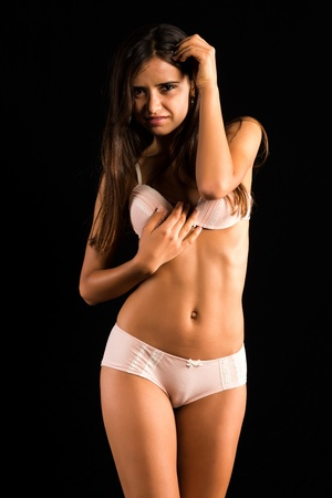 Beautiful slender Romanian brunette in cream colored lingerie photo