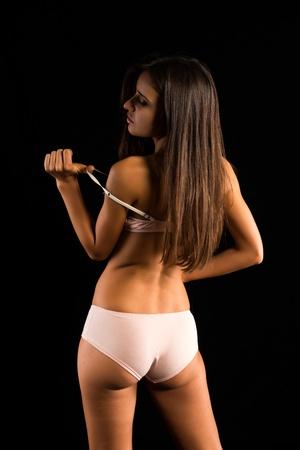 romanian: Beautiful slender Romanian brunette in cream colored lingerie