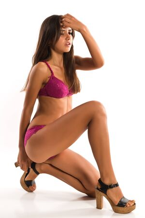 Beautiful slender Romanian brunette in rose colored lingerie photo
