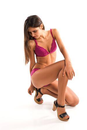 Beautiful slender Romanian brunette in rose colored lingerie photo